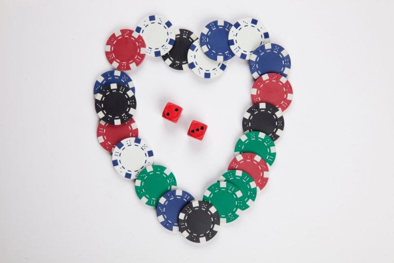 chips shaped as heart with dices in the middle e1521119782821